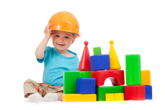 Humor in Customer Experience - Smiling child in hard hat